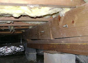 sagging crawl space with wooden shimming a Colstrip crawl space