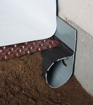 Closeup of a crawl space drainage system installed in Stanford