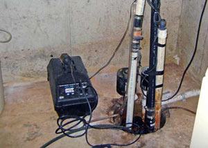 Pedestal sump pump system installed in a home in Crow Agency