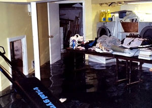 A laundry room flood in Colstrip, with several feet of water flooded in.