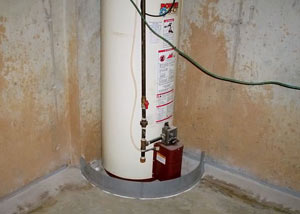 A water heater in Joliet that's been protected by the FloodRing® and a perimeter drain system.