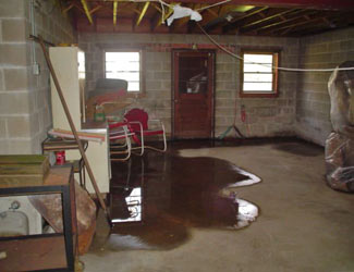 a flooded basement floor in a Busby home