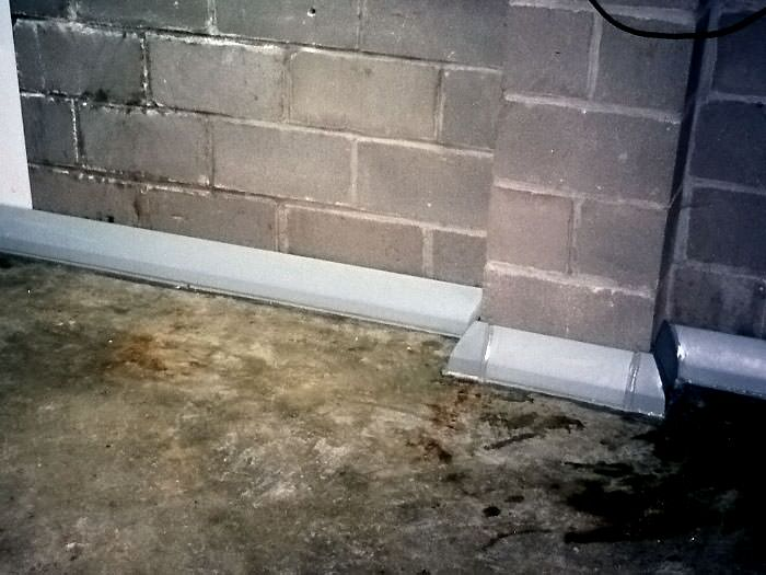 Baseboard Basement Drain Pipe System In Greater Billings