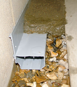 A basement drain system installed in a Roundup home