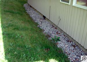 A yard that has been graded to slope towards the foundation in Absarokee